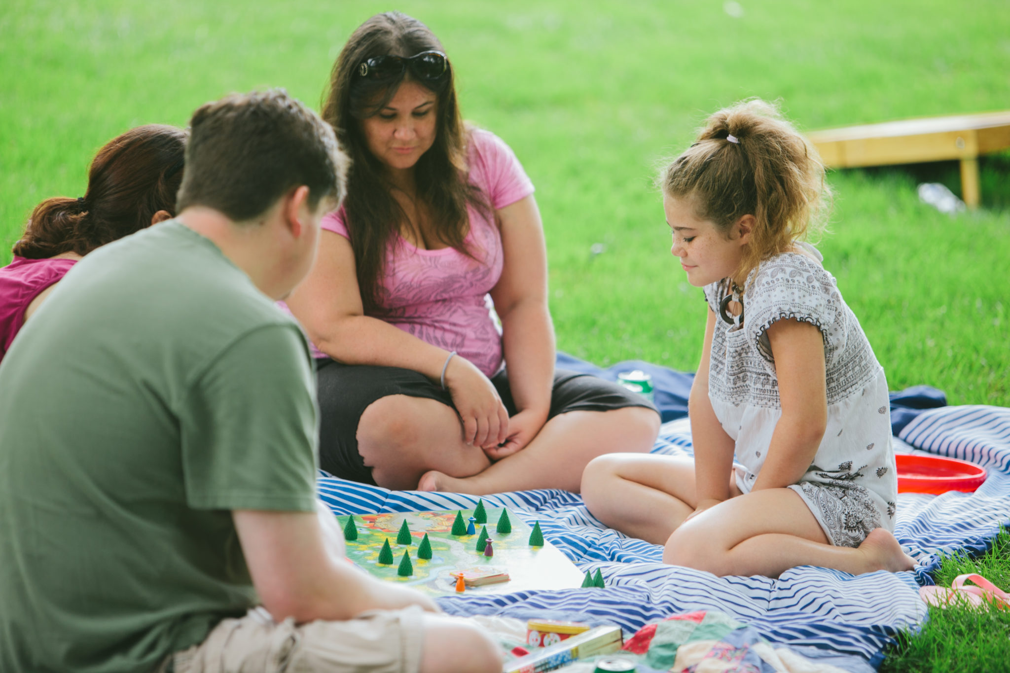 Girl with family at Release Mentoring picnic 2015 Release Inc Community